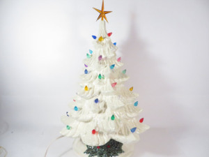 What a sweet white tree with a variety of lights.